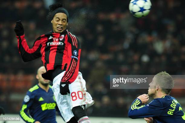 AC Milan's Brazilian forward Ronaldinho heads the ball in front of Ajax Amsterdam's Belgian defender Toby Alderweireld during their Champions league...