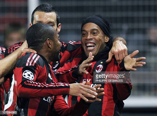 Milan's Brazilian forward Ronaldinho is congratuled by his teammates after scoring a goal during the UEFA Champions League football match Auxerre...