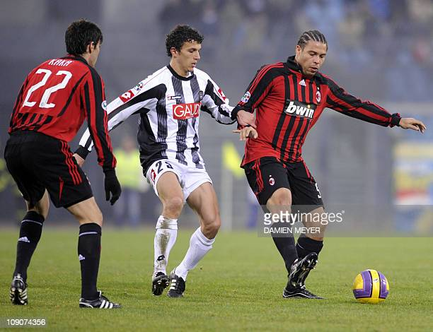 AC Milan's Brazilian forward Ronaldo fights for the ball with Udinese Finnish midfielder Roman Eremenko close to his teammate AC Milan's Brazilian...
