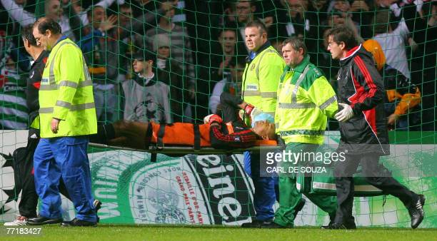 Milan's Brazilian goalkeeper Dida is taken off the pitch after being attacked by a Celtic fan during their UEFA Group D Champions League football...