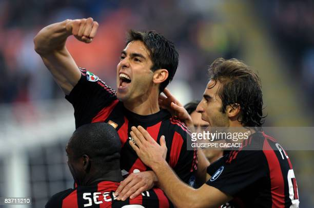 AC Milan's Brazilian midfielder Kaka celebrates after scoring a goal with AC Milan's Dutch midfielder Clarence Seedorf and AC Milan's French...