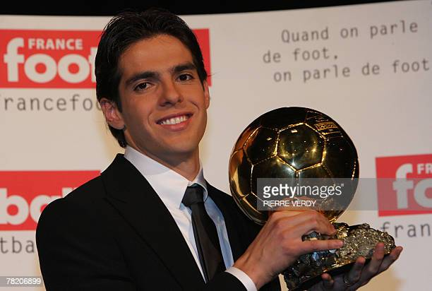 AC Milan's Brazilian midfielder Kaka poses with his trophy after being awarded as France Football's Player of the Year winning the prestigious Ballon...