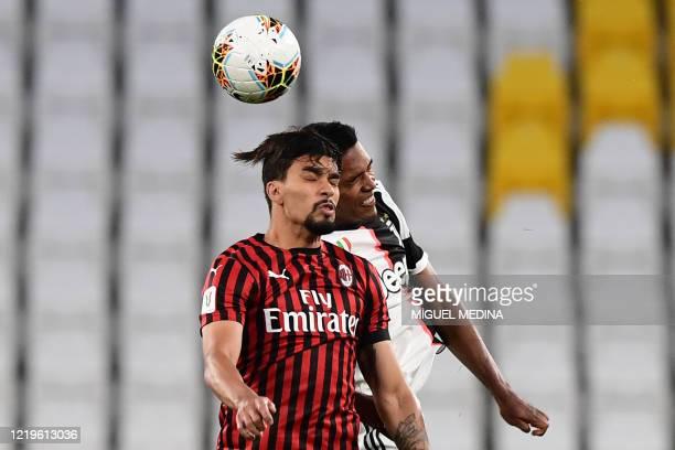 Milan's Brazilian midfielder Lucas Paqueta and Juventus' Brazilian defender Alex Sandro go for a header during the Italian Cup semi-final second leg...