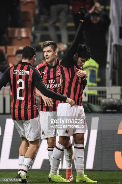 AC Milan's Brazilian midfielder Lucas Paqueta celebrates with AC Milan's Polish forward Krzysztof Piatek and AC Milan's Italian defender Davide...