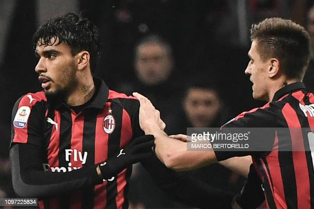 AC Milan's Brazilian midfielder Lucas Paqueta celebrates with AC Milan's Polish forward Krzysztof Piatek after scoring during the Italian Serie A...