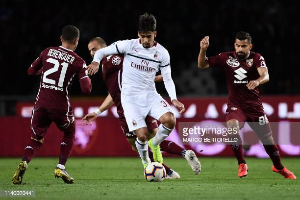 AC Milan's Brazilian midfielder Lucas Paqueta fights for the ball with Torino's Spanish forward Alejandro Berenguer during the Italian Serie A...
