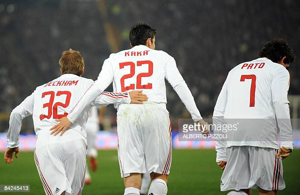 AC Milan's Brazilian Pato celebrates with teammate English midfielder David Beckham and Brazilian Kaka after scoring during his team's Italian Serie...