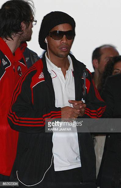 AC Milan's Brazilian player Ronaldinho arrives to the airport in the Qatari capital of Doha on March 3 2009 The Rossoneri will face alSadd on March 4...