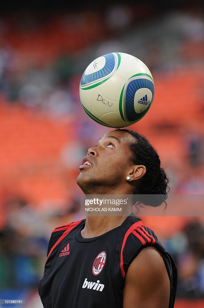 AC Milan's Brazilian star Ronaldinho juggles a ball with his head before a friendly match against DC United at RFK Stadium in Washington on May 26, 2010. AFP PHOTO/Nicholas KAMM