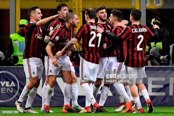 AC Milan's Captain Italian defender Leonardo Bonucci celebrates with teammates after scoring a goal during the Italian Serie A football match between...