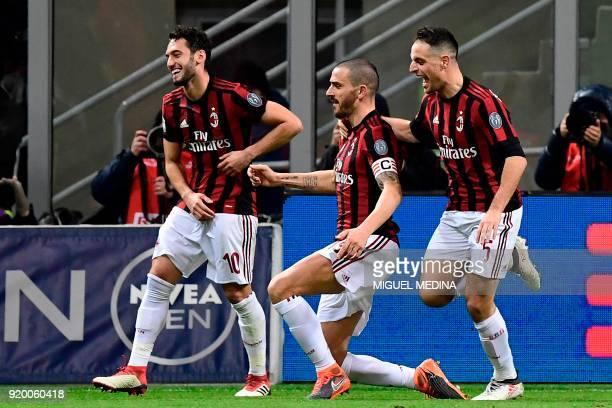 AC Milan's Captain Italian defender Leonardo Bonucci celebrates with teammates German midfielder Hakan Calhanoglu and Italian midfielder Giacomo...