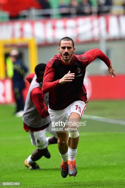 AC Milan's Captain Italian defender Leonardo Bonucci warms up prior the Italian Serie A football match AC Milan vs AC Chievo at the San Siro stadium...