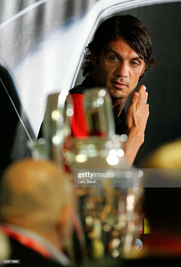 AC Milan's captain Paolo Maldini looks a cross to the Champions League Trophy during a press conference ahead of the European Champions League final against Liverpool on May 24, 2005 in Istanbul, Turkey. The European Champions League final match between AC Milan and Liverpool will take place on May 25.