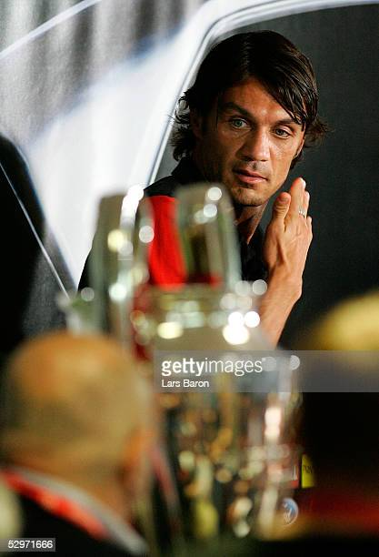 Milan's captain Paolo Maldini looks a cross to the Champions League Trophy during a press conference ahead of the European Champions League final...