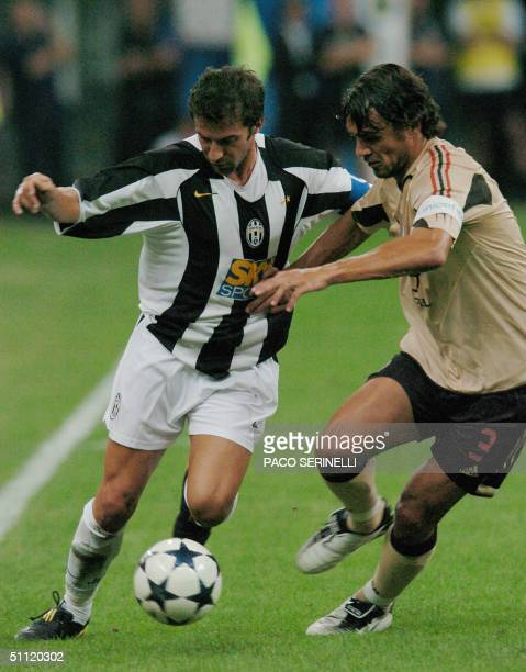 Milan's captain Paolo Maldini tries to stops Alessandro Del Piero of Juventus at Meazza stadium in Milan 27 July 2004 during a friendly football...