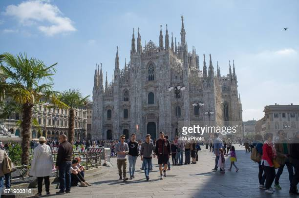 Milan's chathedral known as 'Duomo' is seen with the brand new palm trees in a sunny Sunday morning in Milan on April 23 2017 The brand new garden is...