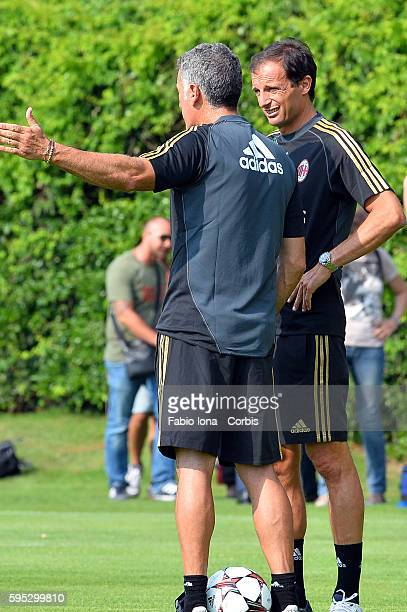 AC Milan's coach Massimiliano Allegri and his vice Mauro Tassotti gestures during a training session at the Milanello training center in Carnago...
