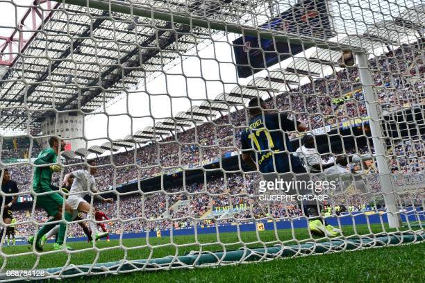 AC Milan's Colombian defender Cristian Zapata scores during the Italian Serie A football match Inter Milan vs AC Milan at 'San Siro' Stadium in Milan...
