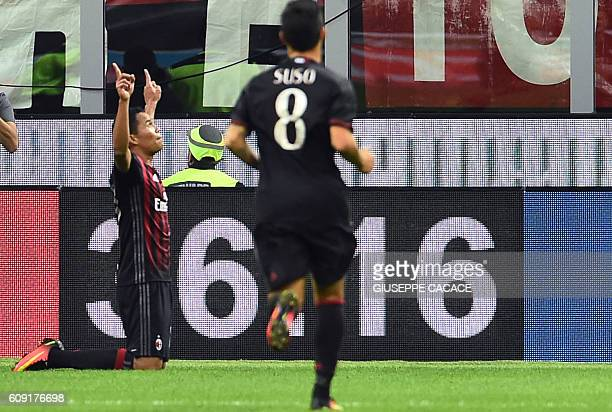 AC Milan's Colombian forward Carlos Bacca celebrates after scoring a goal during the Italian Serie A football match between AC Milan and SS Lazio at...