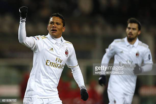 AC Milan's Colombian forward Carlos Bacca celebrates after scoring a goal during the Italian Serie A football match between Torino and AC Milan on...