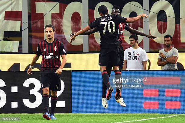 AC Milan's Colombian forward Carlos Bacca celebrates with AC Milan's forward from France Mbaye Niang after scoring a goal during the Italian Serie A...