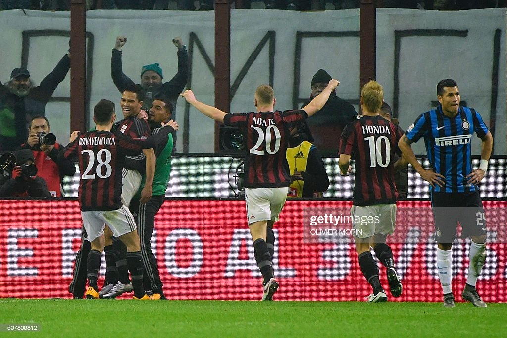 AC Milan's Colombian forward Carlos Bacca (2nd L) celebrates with teammates after scoring during the Italian Serie A football match between AC Milan and Inter Milan at San Siro Stadium in Milan on January 31, 2016. / AFP / OLIVIER