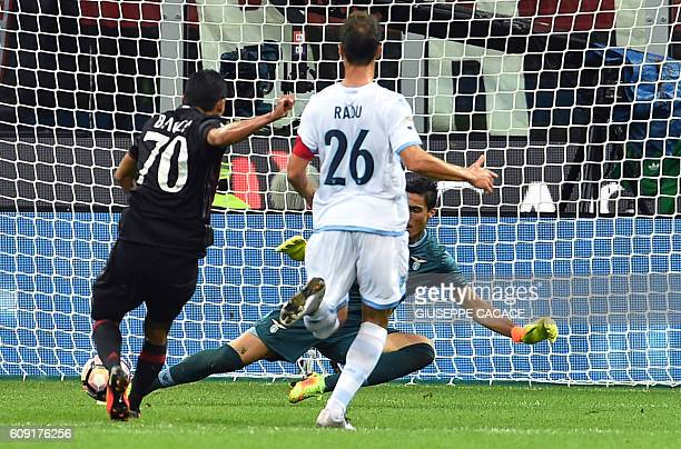 AC Milan's Colombian forward Carlos Bacca kicks and scores a goal during the Italian Serie A football match between AC Milan and SS Lazio at the San...