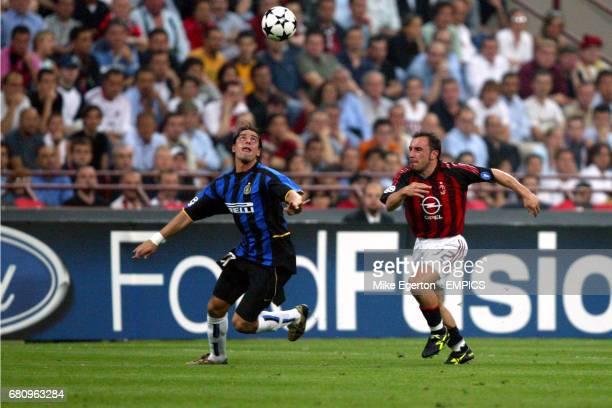 AC Milan's Cristian Brocchi and Inter Milan's Francesco Coco both run for the ball
