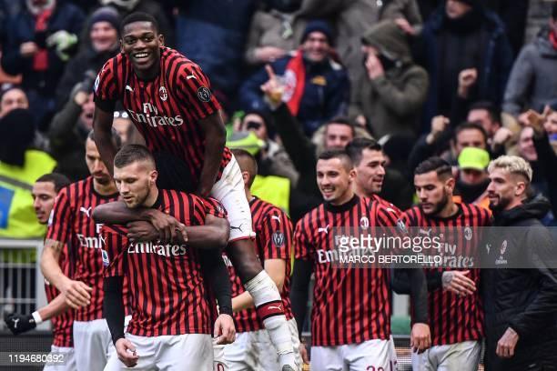 AC Milan's Croatian forward Ante Rebic AC Milan's Portuguese forward Rafael Leao and teammates celebrate after Rebic scored a last second winnin goal...