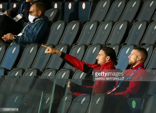 Milan's Croatian forward Ante Rebic and AC Milan's Swedish forward Zlatan Ibrahimovic watch the Italian Serie A football match Atalanta Bergamo vs AC...