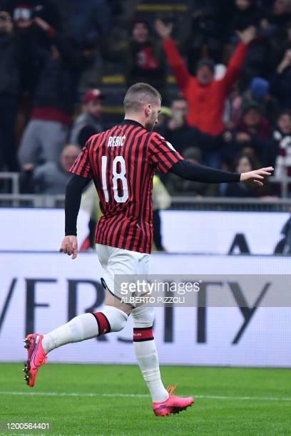 Milan's Croatian forward Ante Rebic celebrates after opening the scoring during the Italian Cup semi-final first leg football match AC Milan vs...