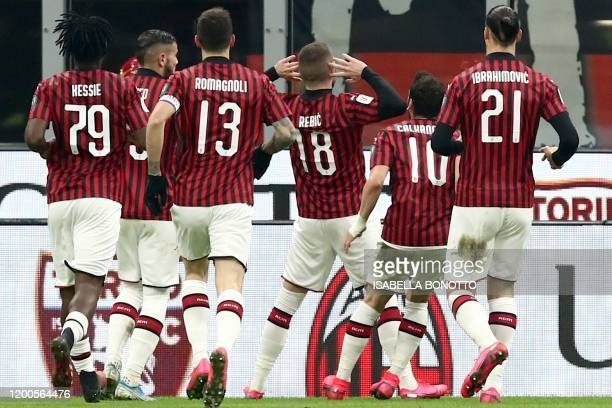 AC Milan's Croatian forward Ante Rebic celebrates after opening the scoring during the Italian Cup semifinal first leg football match AC Milan vs...