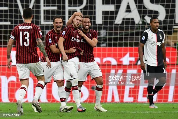 AC Milan's Croatian forward Ante Rebic celebrates after scoring Milan's 4th goal during the Italian Serie A football match AC Milan vs Juventus...