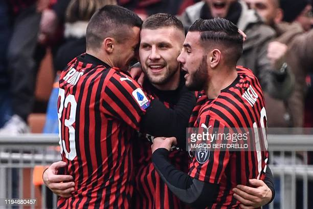 AC Milan's Croatian forward Ante Rebic celebrates with AC Milan's Bosnian midfielder Rade Krunic and AC Milan's French defender Theo Hernandez after...