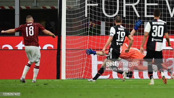 Milan's Croatian forward Ante Rebic shoots to score Milan's 4th goal, during the Italian Serie A football match AC Milan vs Juventus played behind...