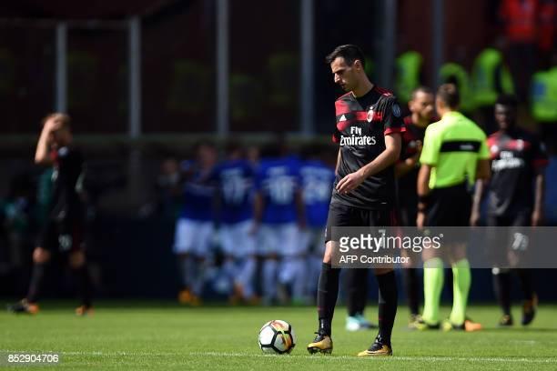 AC Milan's Croatian forward Nikola Kalinic reacts after Sampdoria scored a goal during the Italian Serie A football match Sampdoria versus AC Milan...