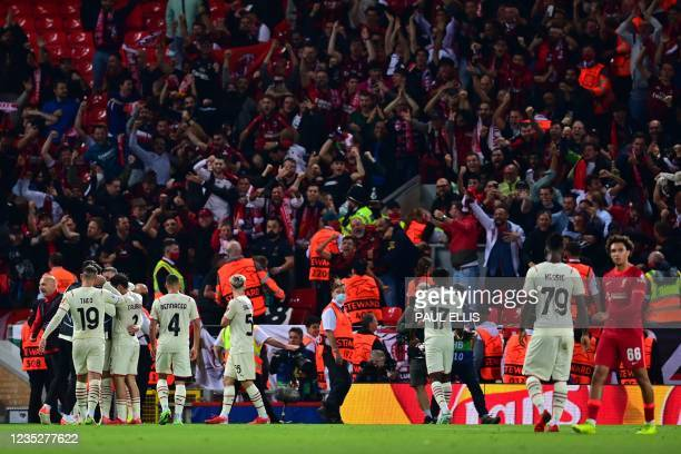 Milan's Croatia's forward Ante Rebic celebrates with team mates after scoring his team's opening goal during the UEFA Champions League 1st round...