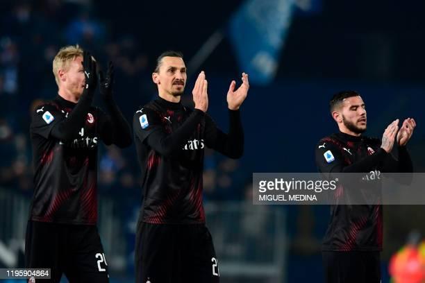 AC Milan's Danish defender Simon Kjaer AC Milan's Swedish forward Zlatan Ibrahimovic and AC Milan's French defender Theo Hernandez applaud at the end...