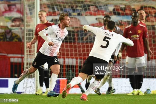 Milan's Danish defender Simon Kjaer celebrates scoring their first goal to equalise 1-1 during the UEFA Europa League round of 16 first leg football...