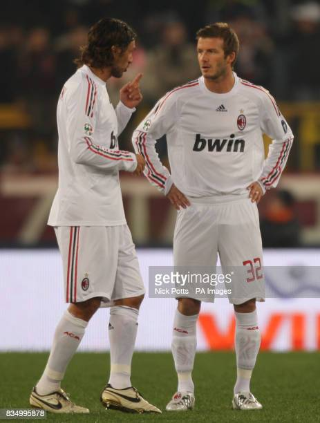 AC Milan's David Beckham on his debut listens to captain Paolo Maldini against Roma at the Olympic Stadium Rome Sunday 11 January 2009 Photo Nick...