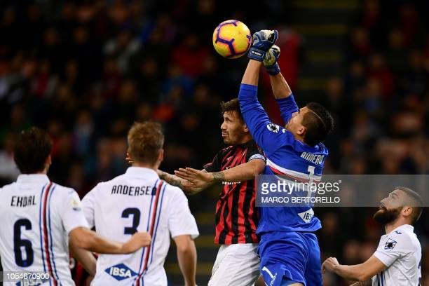 Milan's defender Alessio Romagnoli from Italy fights for the ball with Sampdoria's Italian goalkeeper Emil Audero during the Italian Serie A football...