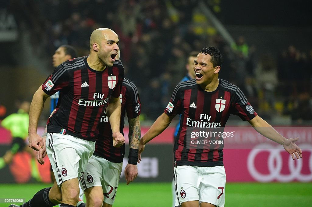AC Milan's defender from Brazil Alex (L) celebrates after scoring during the Italian Serie A football match AC Milan vs Inter Milan on January 31, 2016 at the San Siro Stadium stadium in Milan. / AFP / OLIVIER