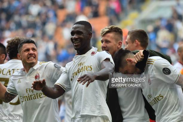 AC Milan's defender from Colombia Cristian Zapata celebrates with teammates after scoring a goal during the Italian Serie A football match Inter...