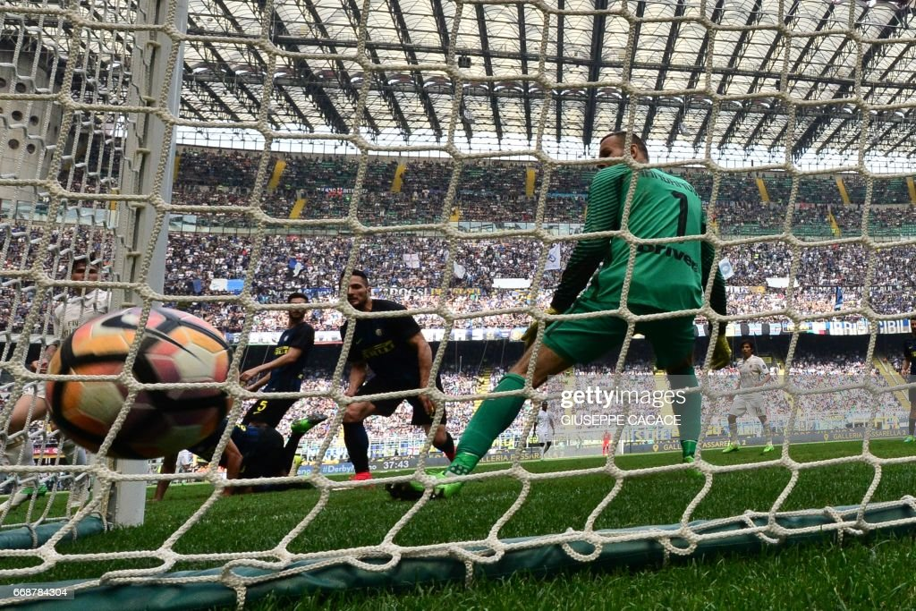AC Milan's defender from Italy Alessio Romagnoli (not seen) scores during the Italian Serie A football match Inter Milan vs AC Milan at 'San Siro' Stadium in Milan on April 15, 2017. The match ended 2-2. /