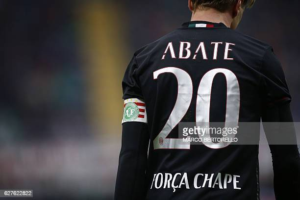 AC Milan's defender Ignazio Abate wears a captain band with the logo of the Chapecoense football club during the Italian Serie A football match AC...