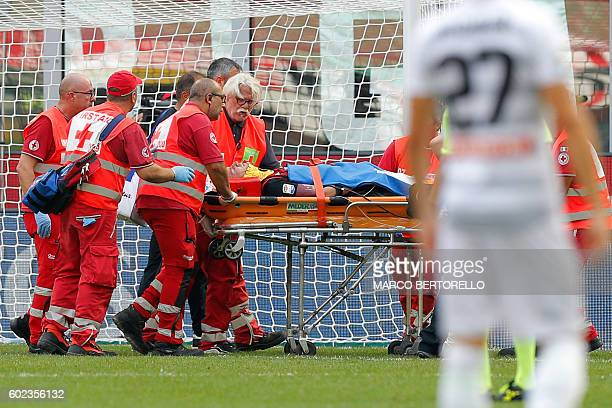 AC Milan's defender Luca Antonelli is evacuated on a stretcher after getting injured during the Italian Serie A football match AC Milan Vs Udinese on...