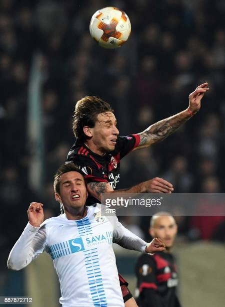 AC Milan's defender Lucas Biglia fights for the ball with Rijeka's midfielder Mario Gavranovic during the UEFA Europa League Group D football match...