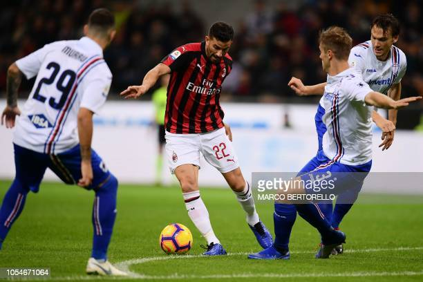 AC Milan's defender Mateo Musacchio from Argentina fights for the ball with Sampdoria's defender Joachim Andersen from Denmark during the Italian...