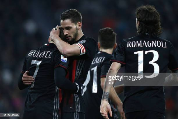 AC Milan's defender Mattia De Sciglio and AC Milan's midfielder Gerard Deulofeu from France celebrate a goal during the Italian Serie A football...