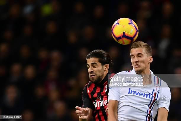 AC Milan's defender Ricardo Rodriguez from Switzerland fights for the ball with Sampdoria's Belgian midfielder Dennis Praet during the Italian Serie...
